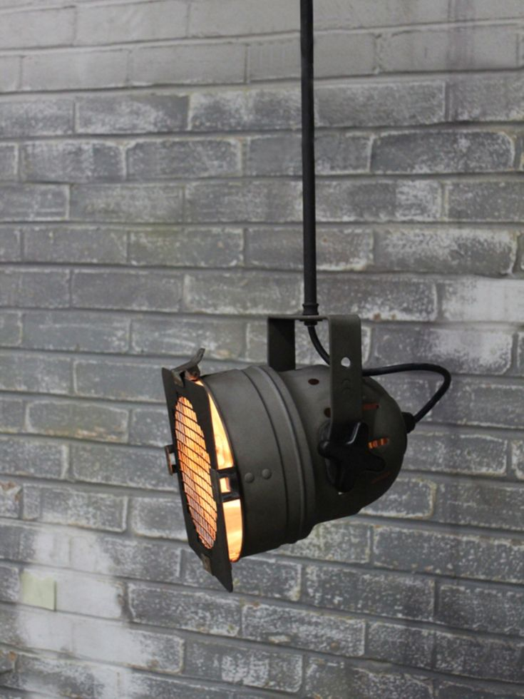 Distressed industrial spot light with suspended ceiling rod
