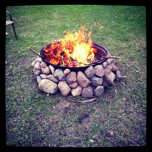 My firepit, made with an old tractor tire rim and stacked stones - love it!