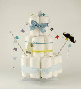 Voici une adorable idée pour un cadeau de naissance ou de «babyshower»* original et personnalisé : offrez un gâteau de couches «fait maison» !  <br />Notre kit Croquencouche modèle Moustache vous permet de monter vous même un gâteau de couches et de le décorer suivant la recette ou selon votre goût ! <br /> <br />A monter soi-même. Couches non fournies.  <br />Les Croquencouches ne peuvent pas être livrés monté. <br />  <br /> <br />