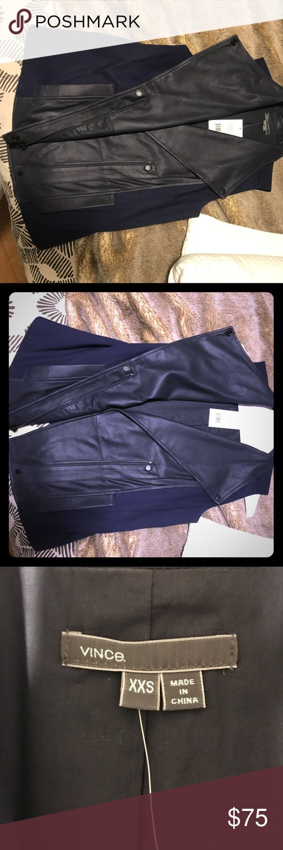Vince Navy Leather and Blue Khaki Vest Vince (never worn! Brand new!) navy leather and blue khaki vest jacket. Size is XXS - it fits anyone from XXS to Medium (I am normally a medium size [i am 5 ft 5 in and 130 lbs.]) and it looks fitted in a cute way on me. Vince Jackets & Coats Vests