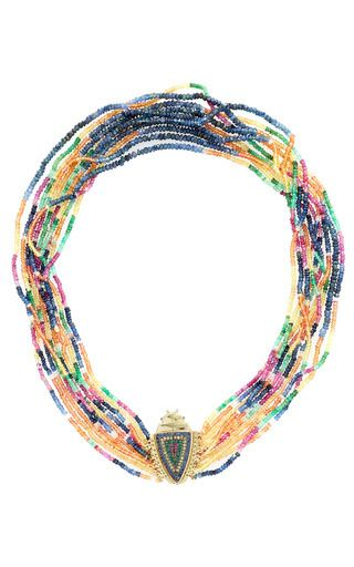 This one-of-a-kind necklace by **Daniela Villegas** blends the symbolism of the beetle and the rainbow with scintillating blue sapphires, yellow sapphires, emeralds, and rubies.