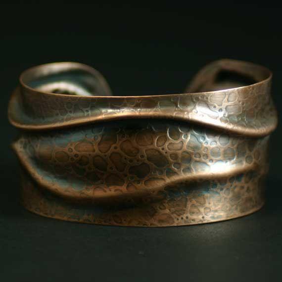 Cuff | Heidi Egerman.  Textured copper with patina.