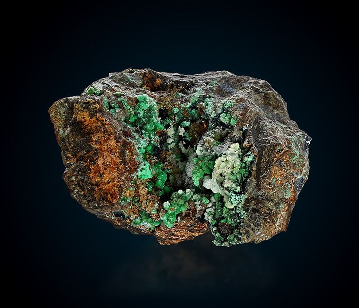 Annabergite Location: Km-3 Mine, Lavrion, Attica, Greece Description: A superb and very rich specimen of annabergite. The druse is rich in annabergite crystal clusters and botryoidal calcite with gaspeite inclusions. An old classic specimen from Lavrion! Intense color, undamaged.