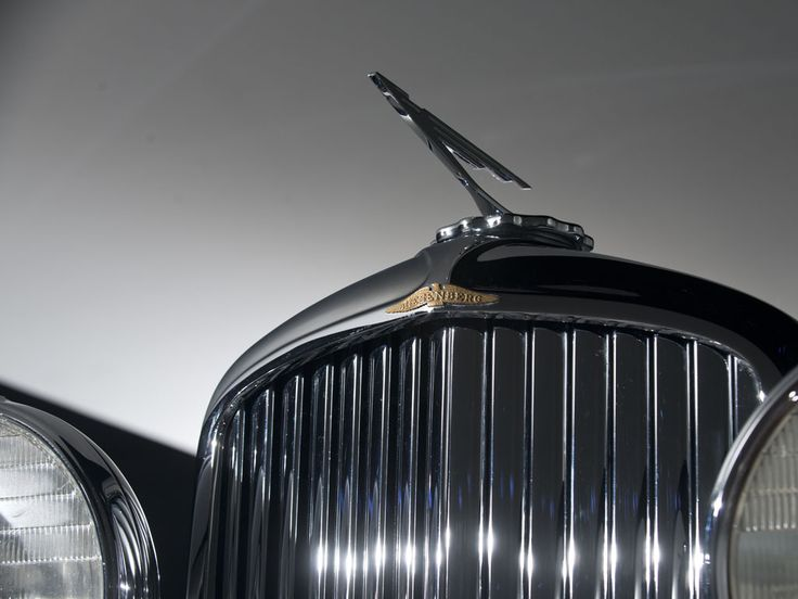 """Designed by J. Herbert Newport, the 1935 Duesenberg Model J convertible coupe features the best styling cues of that era. The traditional upright radiator casing and headlights were accompanied by deeply skirted and rounded fenders. Also, it had classic suicide doors, a narrow """"aerodynamic"""" tilted windshield but the most innovative feature was it's convertible top."""