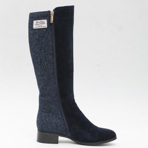 Navy #HarrisTweed Knee High Boots.  -	Genuine Harris Tweed hand woven in the Outer Hebrides, with the Orb mark certifying every pair. -	Flexible boot shaft, with zip fastening -	Calf height 38cm (measures from top of the heel to top of the boot) -	Heel height 3cm -	Sheepskin, suede and Harris Tweed are delicate materials which should be worn with care and nurtured to have the longest wear