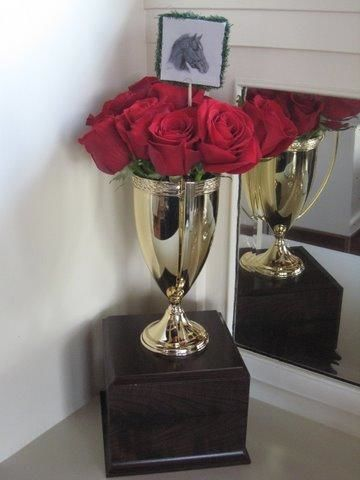 Prepare a gift for the winner by filling a gold trophy ...