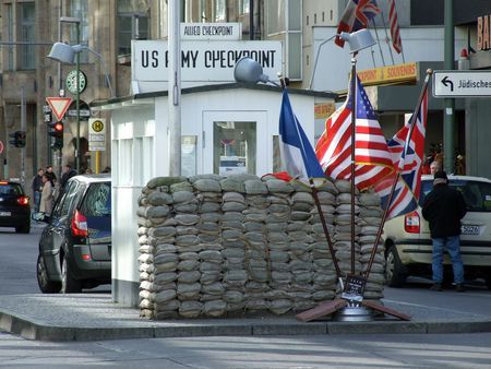 Checkpoint Charlie -- the gateway between East and West Berlin during the Cold War era.