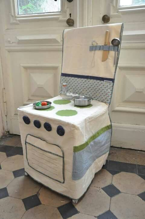 This easy to store/makeshift play kitchen Is a great idea if you can sew..... just slide it over one of your kitchen chairs and let the imaginative fun begin.