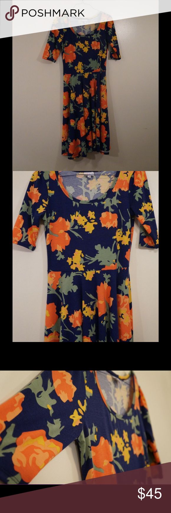 LuLaRoe Nicole Dress Great Nicole dress from LuLaRoe. I just have too much of it and have to start purging! Great condition and a great print I hate to sell. LuLaRoe Dresses