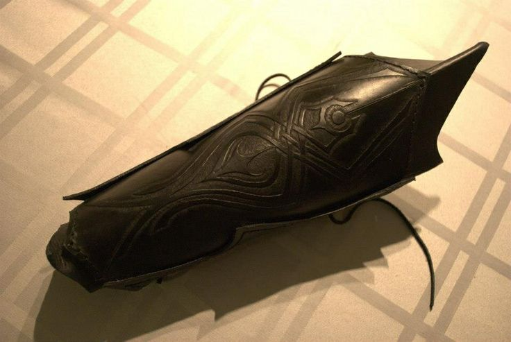Handcrafted bracer made of vegetable tanner leather