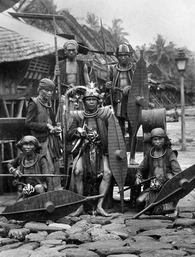 A group of warriors in Hilisimaetano village, South Nias. National Museum of World Cultures. Collection number: TM-60009097.