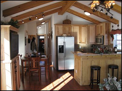 the vaulted ceiling, light oak cabinets, and concrete floors ... on mobile home exhaust fans, mobile home post lights, mobile home wall, mobile home skid light, mobile home accessories, mobile home curtains, mobile home outdoor, mobile home bollard lights, mobile home floor,
