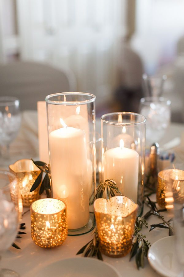 Fall Wedding Table: Using golden mercury glass votives will cast a warm glow all around your table. Especially when paired with simple, cream-colored candles, the effect can be surprisingly dramatic.