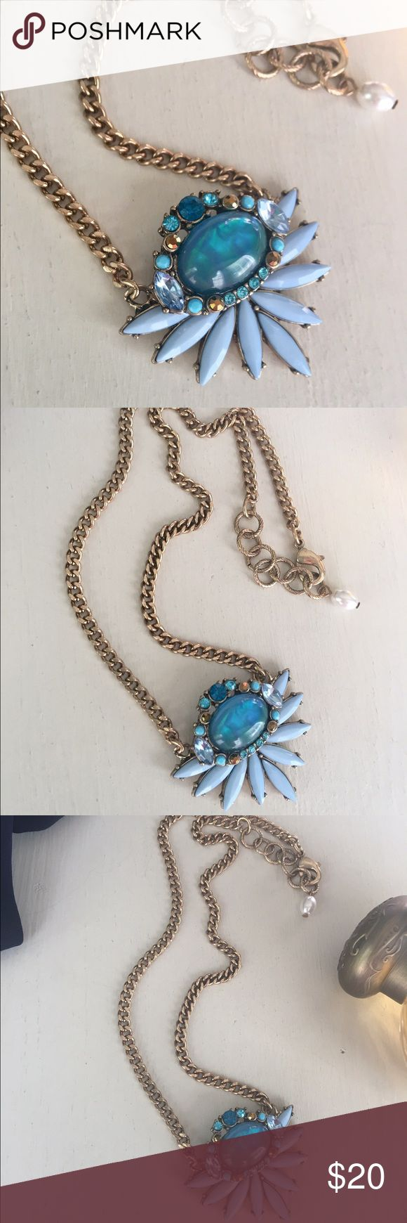 ✨🆕{The Chloe} Blue Blossom + Brass Necklace ✨🆕{The Chloe} Blue Blossom + Brass Necklace✨Striking iridescent blue glass centerpiece✨Milky blue gem petals✨Brilliant blue hued gems✨Brass chain✨Pearl on clasp✨ 🎁Now accepting offers on bundles! Jewelry Necklaces