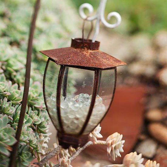 DIY Garden Accent - Hint of Sparkle Place glass beads into an unused lantern for a subtle, decorative touch. The shimmering beads will add sparkle to your outdoor gathering space. Choose colored beads for a bolder look.