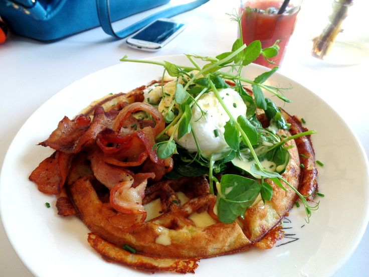 Savoury goats cheese waffles with a poached egg and bacon from Superette