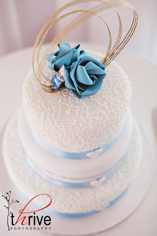 Two flower cake topper with high loops and paua pieces.  www.flaxation.co.nz