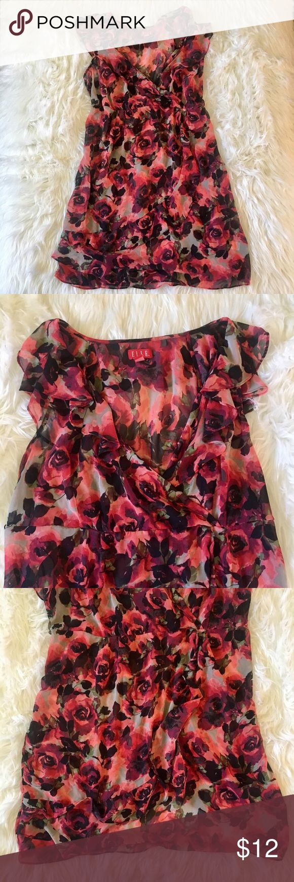 PLUS SIZE ROSE FLORAL SUMMER DRESS LIKE TORRID 💠FLOWY AND SEMI SHEER RED ROSE FLORAL DRESS. 💠HAS A V NECK LINE AND ZIPPER SIDE. 💠BOTTOM PART OF THE DRESS COMES AND DRAPES OVER! 💠REALLY CUTE FOR THIS SUMMER WITH SOME SANDALS AND CURLY HAIR! 💠BRAND IS LIKE TORRID. LABEL IS ELLE IN A 3X 💠FIND LISTING ON MERCARI FOR CHEAPER RATE! torrid Dresses Midi