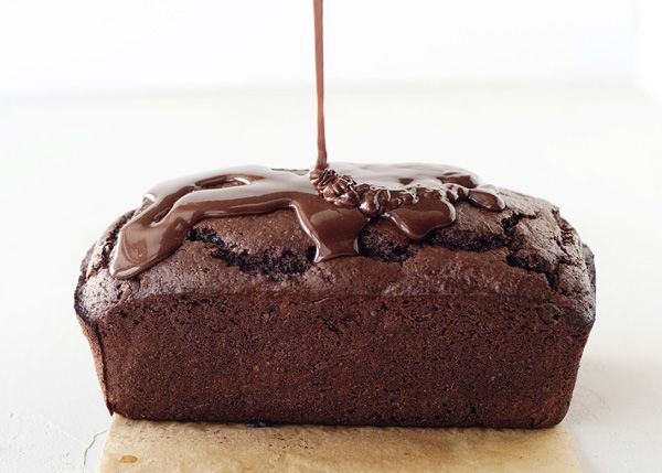 Chocolate Yogurt Cake - Adding yogurt works the same way that adding buttermilk does, it adds a tang and tenderness to whatever you are baking. This cake is rich, a little goes a long way. My favorite part is the glaze. I love how gorgeous and shiny it makes the cake look. #dessert