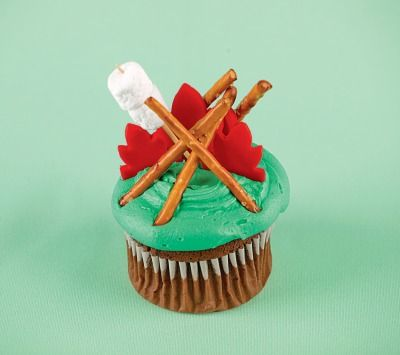 With pretzel sticks as logs and fondant as fire (you can also use red candy fruit slices), these cupcakes will add spark to the party.