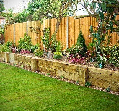 Landscape idea- raised bed next to the fence. / This would be great next to the ugly area. I want to put the big fence up to someday. Don't want to see there yuck!