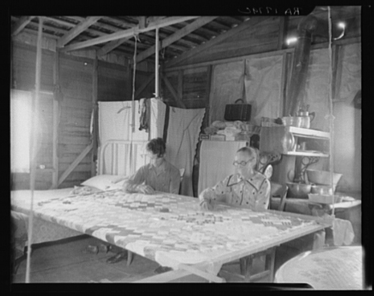 Grandmother from Oklahoma with grandson, working on quilt. California, Kern County. 1936, by Dorothea Lange