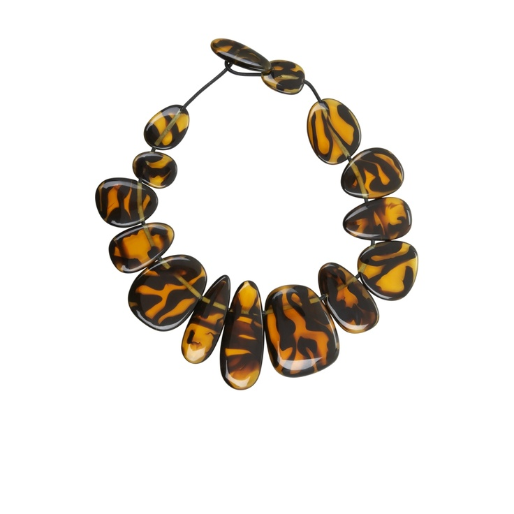 Classic tortoiseshell meets surfer chic style in this beaded necklace. We'd pair this with a pop of Zoya Nail Polish Paz!
