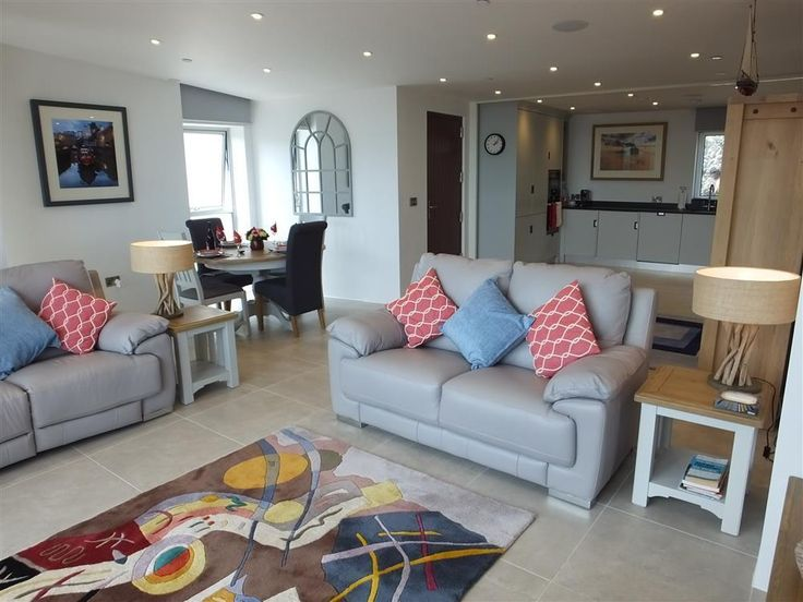 Take a look at the five star waters Edge 15, Tenby. Located literally on the South Beach this stunning brand new apartment sleeps four people and has parking. Prices from £750 to £1500 for a week. Call 01834 844565 today to book.