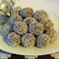 Simple Chocolate Coconut Balls are a good gift giving activity to do with your toddler.  They can help with the mixing.  To make it easier to roll the balls evenly, roll the mixture into a log and cut off even pieces, then roll into a ball.  Finally roll in coconut.  Cute little patty pan papers are great to place them in to look ready for giving.