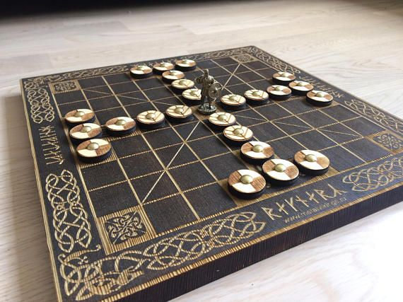 Tafl (Hnefatafl) Vikings Board Game, Kings Table, Scandinavian Game, Vikings Chess Meterial: wood Board size: 300х300х15 mm Game pieces: 25 pieces Made in Russia History: Tafl games are a family of ancient Germanic and Celtic strategy board games played on a checkered or latticed