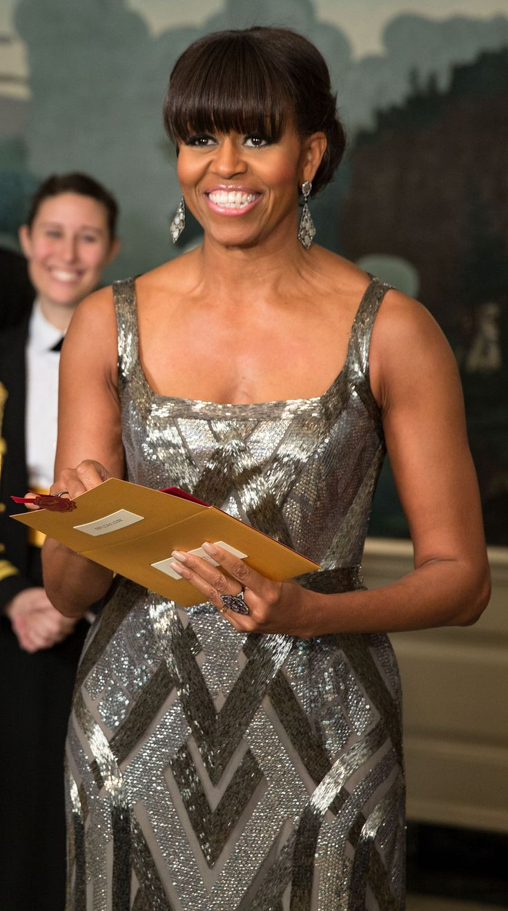 First Lady Michelle Obama certainly looked Oscar worthy in a silver, pewter, and gray metallic beaded dress and matching drop earrings as she announced the winner of the Oscar for Best Picture: Argo, the story of the rescue of six Americans from the Canadian embassy in Iran during the hostage crisis