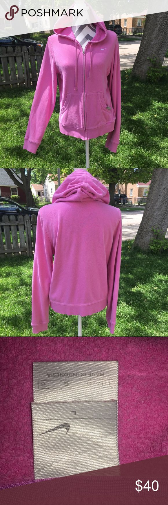 Nike women zip up sweater Hot in pink zip 🤐 up sweater by Nike. Women sweater in excellent condition no stains. Zipper works great. Size is Large color is pink. Nike Sweaters