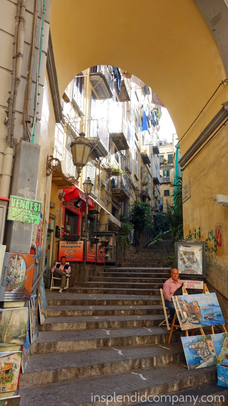 An archway over a staircase in Chiara. An artist sells his paintings, a garden is just out of sight at the top of the stair!