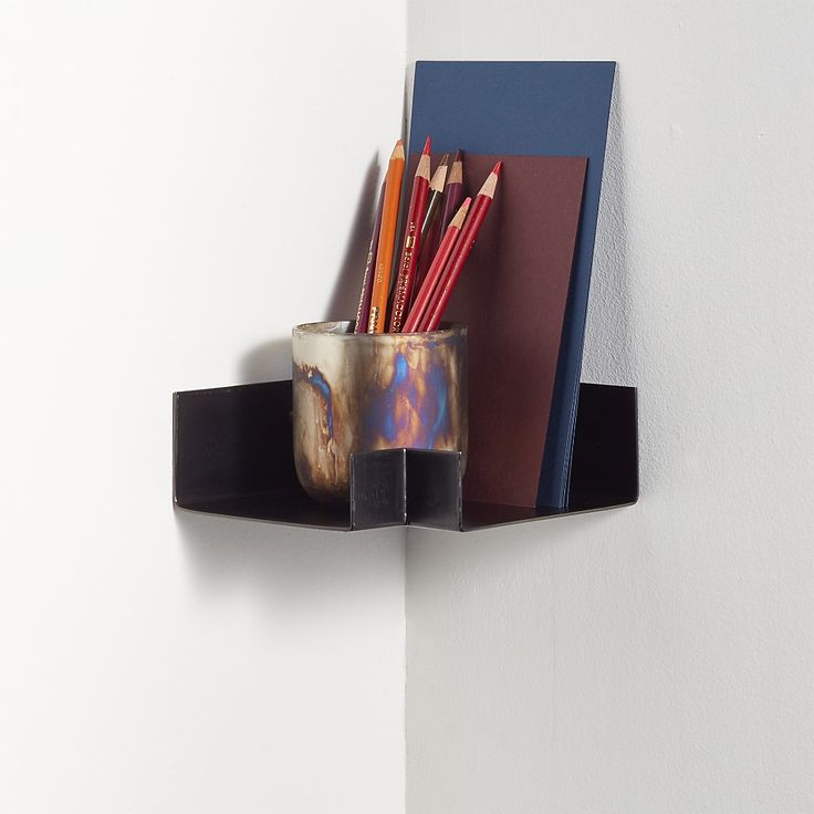 "Shop Gunmetal Corner Wall Shelf. Steel ledge with gunmetal finish turns the corner to nest small accessories and collectibles. Ideal for connecting our 24"" and 28"" gunmetal shelves to create a display that wraps around a room."