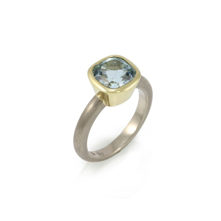 Limited Edition Aquamarine Stone Ring  9 carat white gold ring with 8mm cushion Natural Aquamarine (2.31 carats) set in polished 18 carat yellow gold. Limited edition – a natural aquamarine of this quality is rare. Only one.
