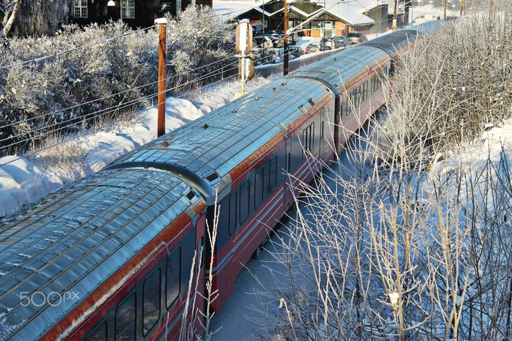 Norwegian Train by Winter - A train passing trough a small town by winter.