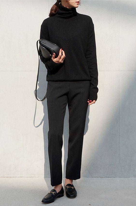 Slacks. Turtle. Loafers. All black! Small bag. Biker if cold.