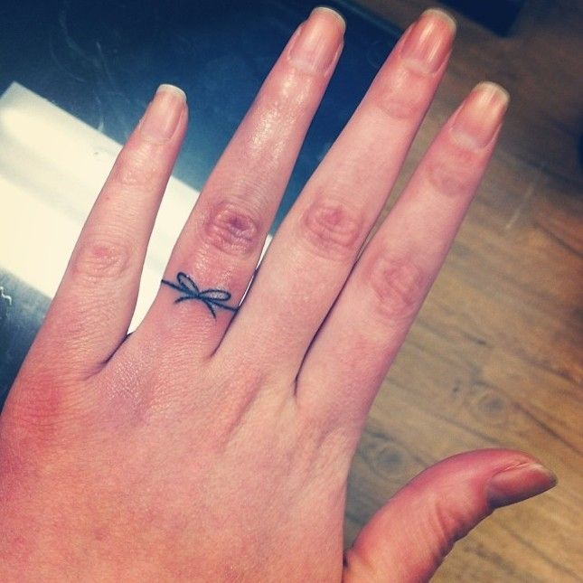 Here's a clever wedding band tattoo idea: Symbolize tying the knot with a tattoo of a knot or ribbon.