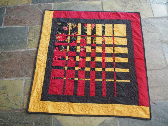 I used Ricky Timms convergence technique to make this beauty, which measures 32 in square. An Asian Lily was deconstructed then reconstructed, using black and gold fabrics of varying widths, to create multi-layered views that are distinctly different and quite unique! What makes the quilt versatile is that it can be used/hung from any side, depending on the view you would like to feature!  It was made from all cotton fabrics, including the wadding and threads. The quilt was machine pieced…