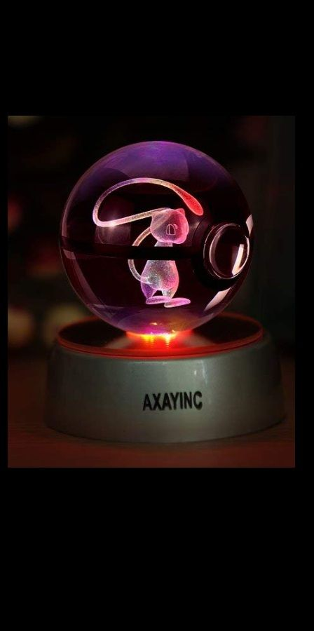 a glowing mew in a transparent poke ball gaming nintendo mew