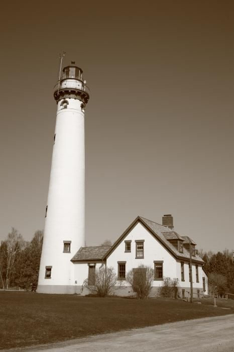 Lighthouse - Presque Isle, Michigan. In sepia. Bright sunny morning for Lake Huron light, with tower and keepers house.