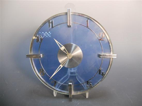 An Art Deco blue glass and chrome clock