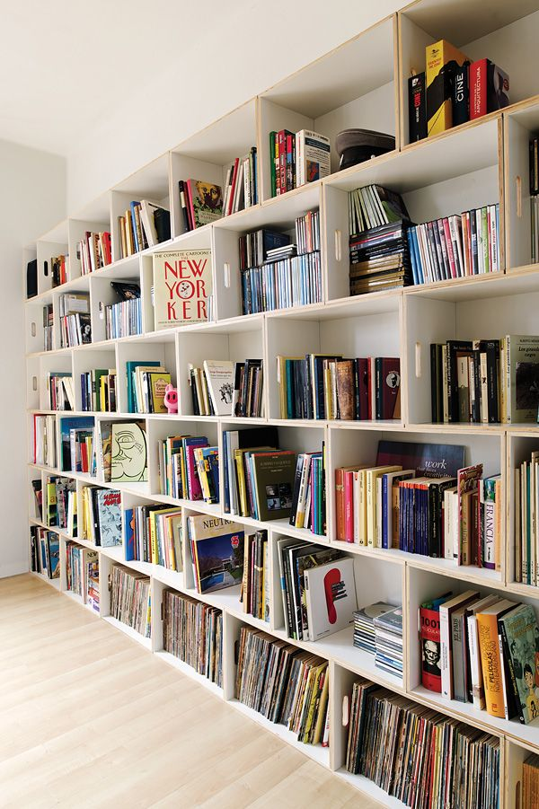 Wall Of Shelves Made From Book Bo Maybe Use Wooden Crates Like This For Storage Under Loft