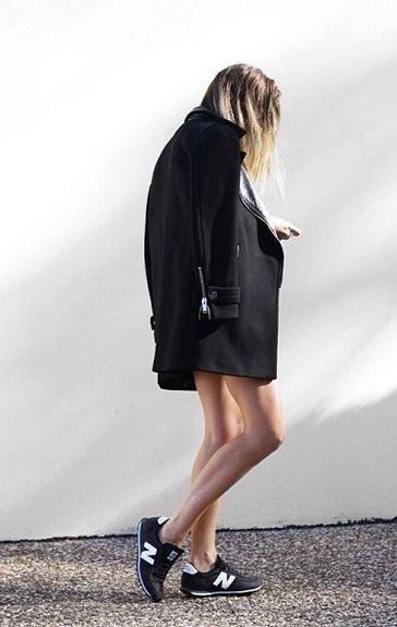 New Balance sneakers and a black wool coat