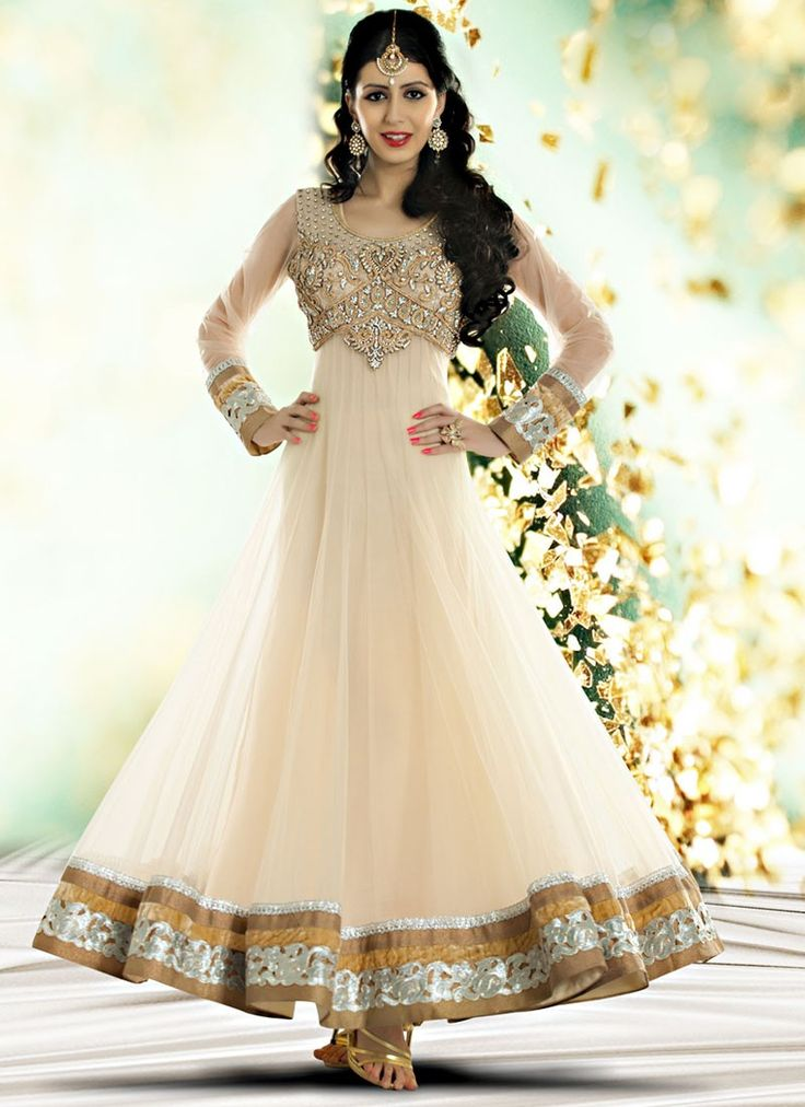 Shop this product from here.. http://www.silkmuseumsurat.in/sweet-cream-net-anarkali-salwar-suit?filter_name=4565  Item #4565  Color : Off White Fabric : Net Occasion : Bridal, Party, Reception, Wedding Style : Anarkali Dress Work : Diamonds, Hand Work