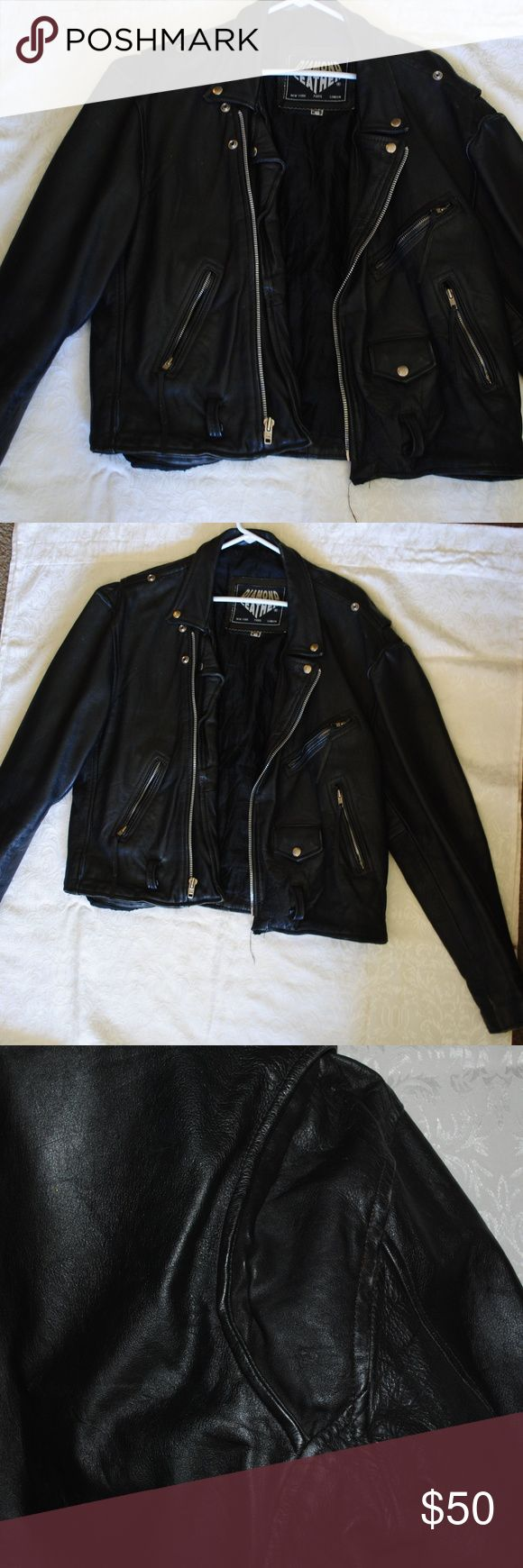 Men's Leather Jacket Motorcycle/Fashion leather jacket Euro 46 so a US small/medium. The jacket is fairly heavy, so if you're looking for a lighter faux jacket this is not it. This is NOT faux leather. Brand new these jackets run around $200. I truly believe it could fit in women's sizing as well. It fits my torso well (and I'm usually a Medium); however, the sleeves are approx. two hand lengths too long on my arms. Very minimal, unnoticeable wear. Diamond Leather Jackets & Coats