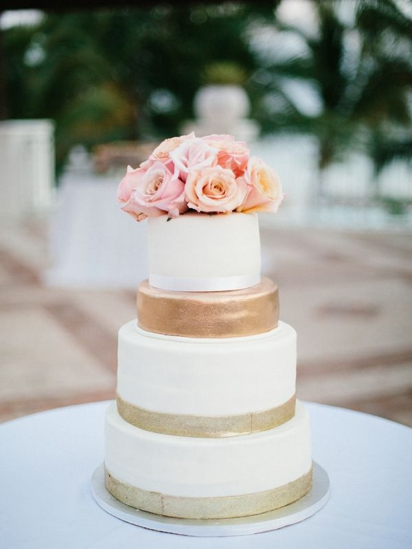 Gold, Ivory, and Blush Wedding Cake  Photography: Asia Pimentel Photography Read More: http://www.insideweddings.com/weddings/nfl-super-bowl-winner-brandon-mcmanus-dominican-republic-wedding/838/