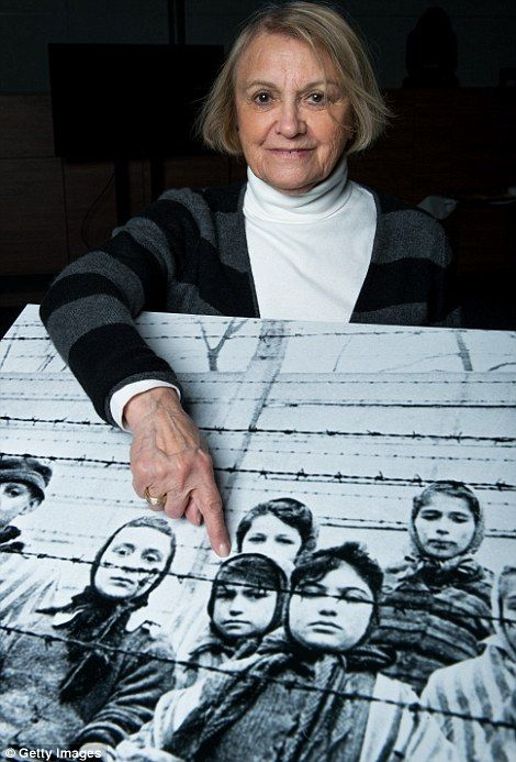 Paula Lebovics points to herself in a group photo taken the day that Auschwitz was freed by the Soviet army, 70 years later.