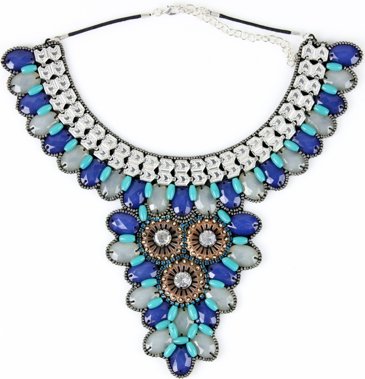 This necklace is part of our signature collection. It is fully hand beaded and creates a striking collar. The cool marine inspired colour palette lends itself perfectly to warm weather. Think summer brights, maxi dresses, low v necklines and days spent on the sand.