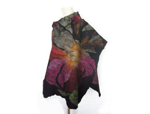 Le châle est feutrée avec de la laine mérinos noir super doux à la main et pièces de gaze de soie et coton teint. Les trous font partie de la conception pas un défaut.  Doux et léger.  Mesures approximatives: 20 x 79  Laver à leau fraîche à la main, presser doucement (ne pas essorer) sèche à plat sur une serviette.  Si vous avez des questions nhésitez pas à menvoyer un mail.  Je vais envoyer lobjet dans les 48 heures du paiement à ladresse vous fournissez lors de votre paiement PayPal…